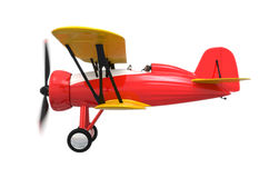 Vista lateral do biplano vermelho e amarelo no fundo branco Fotografia de Stock Royalty Free