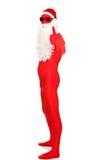 Vista lateral Santa na roupa do látex com polegares acima Imagem de Stock Royalty Free