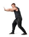Vista laterale del giovane muscoloso bello che spinge qualche cosa di pesante isolato su fondo bianco Fotografie Stock