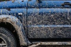 Vista laterale dell'automobile sporca Fotografie Stock