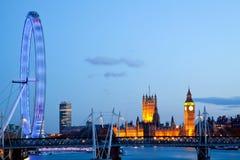 Vista laterale dell'occhio di Londra con grande Ben Fotografie Stock Libere da Diritti