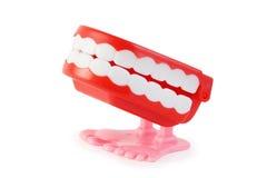 Vista laterale della mascella del movimento a orologeria del giocattolo sui piedini dentellare immagine stock libera da diritti