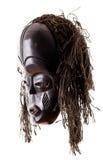 Vista laterale della mascherina tribale su bianco Fotografie Stock