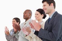 Vista laterale di businessteam d'applauso fotografie stock