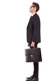 Vista laterale di un uomo o di un allievo di affari che osserva in su Immagini Stock
