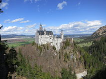 Vista lontana del castello di Neuschwanstein Immagine Stock