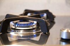 Vista a macroistruzione di funzionamento d'acciaio moderno del fornello Immagine Stock