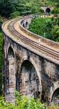 Vista oltre un ponte di nove arché Fotografia Stock