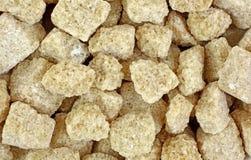 Os cubos do cana-de-açúcar fecham-se acima Foto de Stock