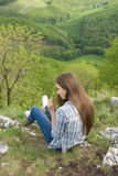 The vista point. Gorgeous young brunette woman enjoying the view from vista point Stock Image