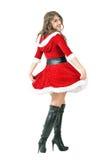 Vista posterior de la muchacha de Papá Noel que hace girar y que da vuelta principal a la cámara Fotografía de archivo