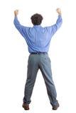 Vista posterior de un hombre de negocios Raising sus puños Foto de archivo libre de regalías
