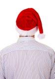 Vista posterior de un hombre en Santa Hat Imágenes de archivo libres de regalías