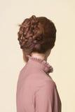 Vista posterior de un tocado hermoso de las coletas Fotos de archivo