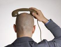 Vista posterior de una cabeza calva imagenes de archivo