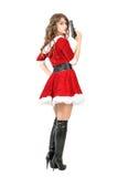 Vista posterior del fatale peligroso del femme en el traje de la Navidad que sostiene el arma que da vuelta principal en la cámar Foto de archivo libre de regalías
