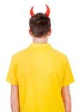 Vista posterior del hombre con los cuernos del diablo Fotografía de archivo