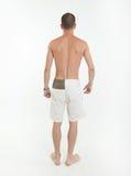 Vista posterior del hombre en troncos de natación Foto de archivo libre de regalías