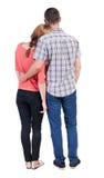 Vista posteriore dei giovani che abbracciano le coppie Immagine Stock Libera da Diritti
