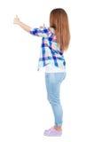 Vista posteriore dei pollici della donna su Fotografie Stock