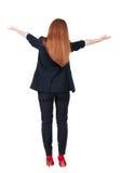 Vista posteriore di bei benvenuti della donna di affari Fotografie Stock