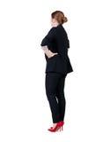 Vista posteriore di contemplazione della donna di affari della testarossa Immagini Stock Libere da Diritti