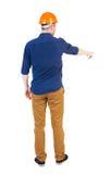 Vista posteriore di indicare i giovani in camicia ed in casco Immagini Stock