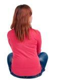 Vista posteriore di seduta della donna Immagini Stock Libere da Diritti