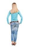 Vista posteriore di stare giovane bella donna in jeans Fotografia Stock Libera da Diritti