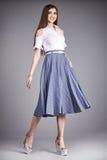 Vista a saia da blusa da coleção do modelo do estilo da forma da roupa da mulher fotografia de stock
