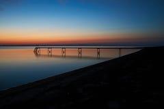 Vista sobre o fiorde na praia de Vadum após o por do sol Imagens de Stock Royalty Free