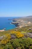 Vista sobre a paisagem litoral da ilha grega Mykonos na mola, greece Imagem de Stock