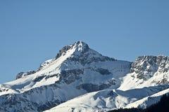 Vista soleggiata di alte alpi austriache di Tauern nell'inverno Fotografia Stock