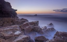 Vista sul mare di alba alla spiaggia di Wollongong Fotografia Stock