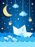 Vista sul mare di fantasia con la barca di carta, di notte Immagine Stock