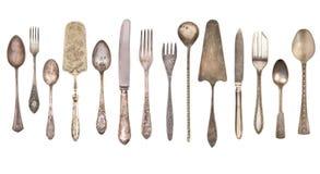Vista superior da faca, da colher bonita e da forquilha da prata do vintage isoladas no fundo branco silverware fotografia de stock