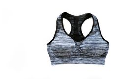 Vista superior da roupa do Sportswear As mulheres são preto e Gray Sports Bra Isolated Acessórios do esporte e forma, estilo de v imagens de stock