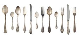 Vista superior das facas, de colheres bonitas e das forquilhas da prata do vintage isoladas no fundo branco silverware imagens de stock royalty free