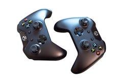 Vista superior de dois controladores pretos de Sony PlayStation para jogar videogames Isolado no branco imagem de stock royalty free