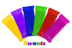 Vista superior del bocado de la bolsa plástica que empaqueta para las obleas del chocolate Imagen de archivo