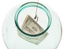 Vista superior del dólar pasado de cogida del tarro de cristal Foto de archivo libre de regalías