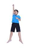 Vista superior del parecer asiático feliz del niño el super héroe del vuelo, isolat Fotografía de archivo libre de regalías