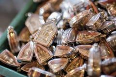 Vista superior dos muitos amuleto pequeno da imagem da Buda Foto de Stock Royalty Free