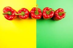 Vista superior em cinco pimentas vermelhas doces Imagens de Stock Royalty Free
