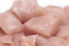 Vista superiore dei bei pezzi crudi del raccordo del pollo isolati su bianco Immagini Stock Libere da Diritti