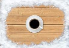 Vista superiore del caffè della tazza con neve Fotografia Stock