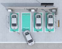 Vista superiore del parcheggio di car sharing fornito del caricare stazione e le batterie Illustrazione di Stock