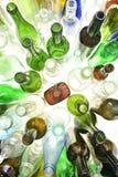 Vista superiore delle bottiglie di vetro su bianco Fotografia Stock Libera da Diritti