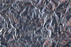 Vista superiore di struttura argentea scura del fondo della stagnola Fotografia Stock