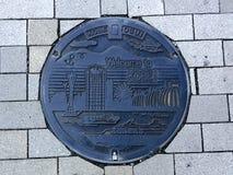 Vista superiore di una botola decorata di Kobe City, Giappone fotografia stock libera da diritti